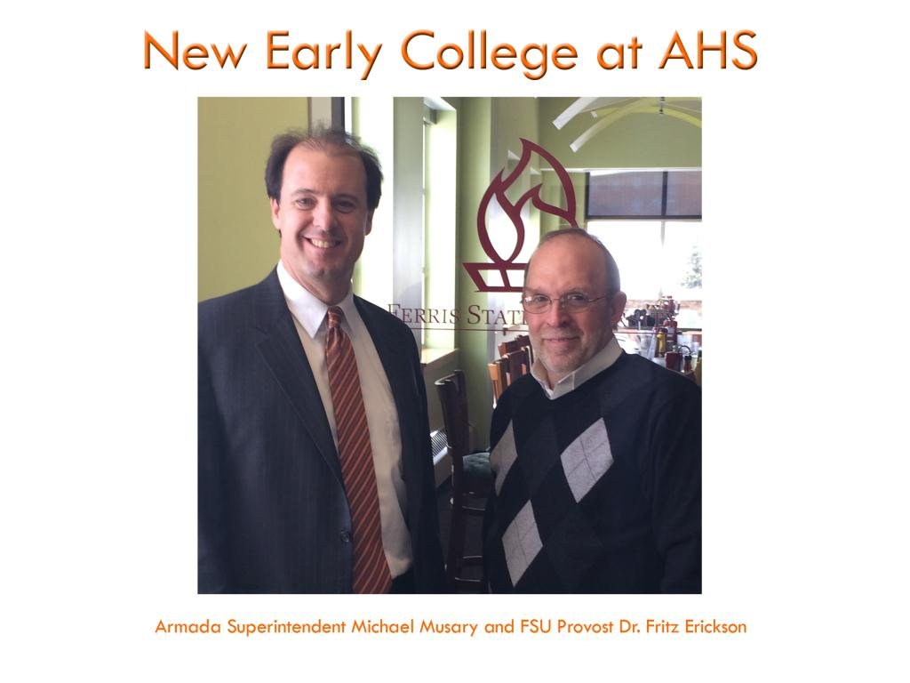 Photo promoting the new early college program at AHS. Armada Superintendent Michael Musary and FSU Provost Dr. Fritz Erikson pose together in front of the Ferris State torch logo representing the cooperation between the two educational institutions.